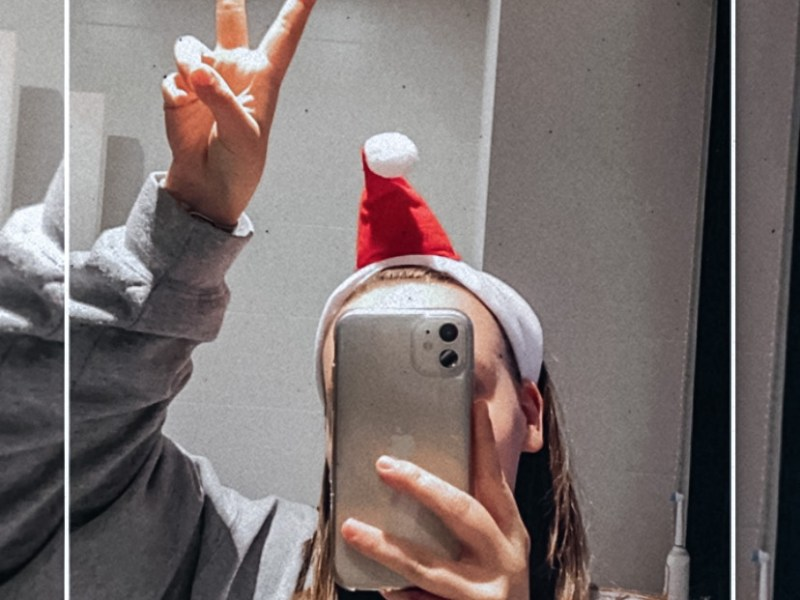 peace pose with a santa hat, obvs